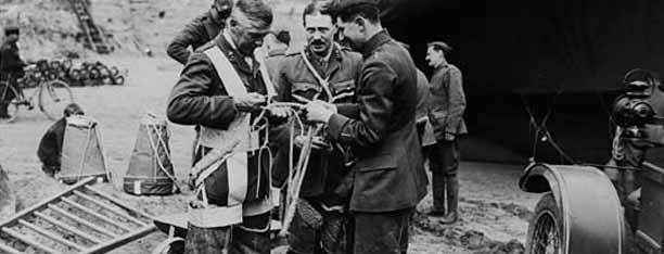 Observers fixing tackle which is connected with parachute by National Library of Scotland, on Flickr